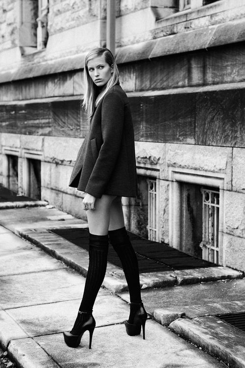 Choose a black pea coat to create a chic, glamorous look. Finish off your look with black leather pumps.  Shop this look for $59:  http://lookastic.com/women/looks/black-pea-coat-and-black-knee-high-socks-and-black-leather-heels/2337  — Black Pea Coat  — Black Knee High Socks  — Black Leather Pumps