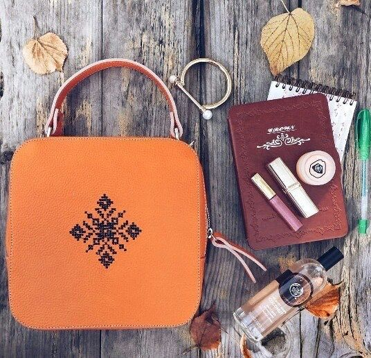 All the essentials to start the new year in style. Orange magpie with black embroidery.