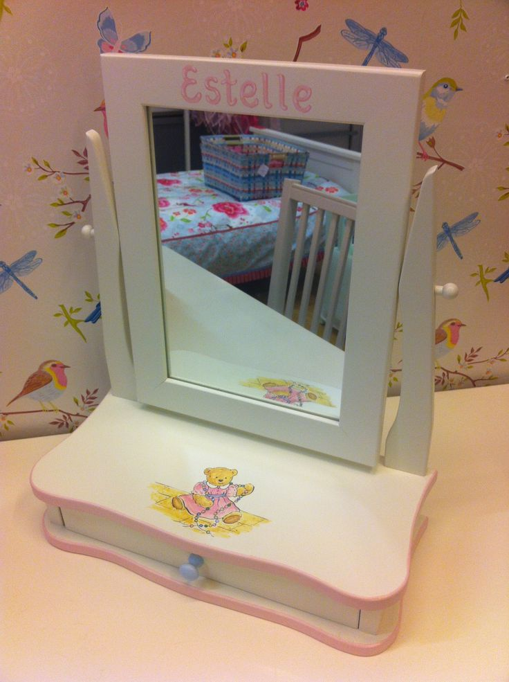 Mirror with drawer with handpainted motif and name.