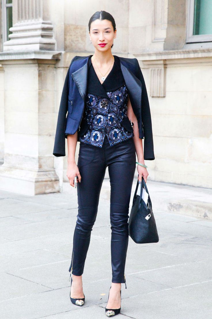 Style a pair of sleek navy-blue leather pants with an embellished top for an alluring chic look.