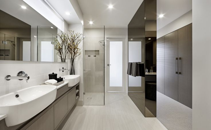 Adding in some glamour the bronze finish mirrored divider wall between the walk in robe and ensuite looks divine.