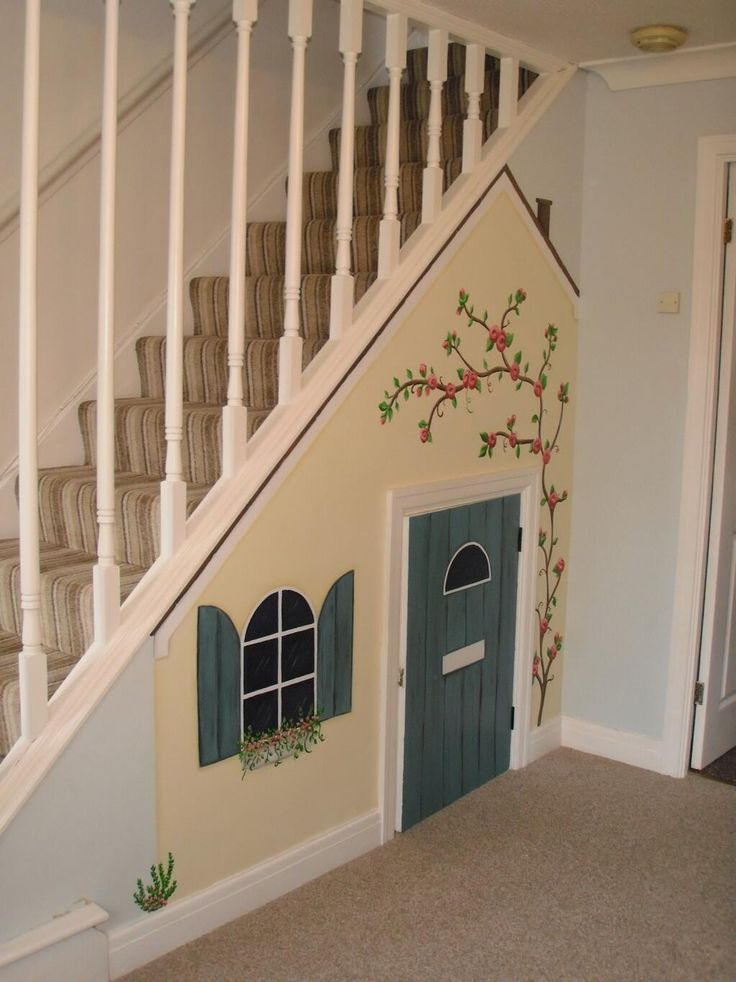 Kids under stairs playhouse mural www.custommurals.co.uk