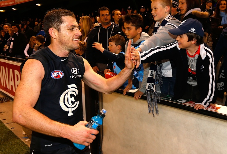 Celebrating with fans during the 2012 AFL Round 20 match against the Brisbane Lions at Etihad Stadium.