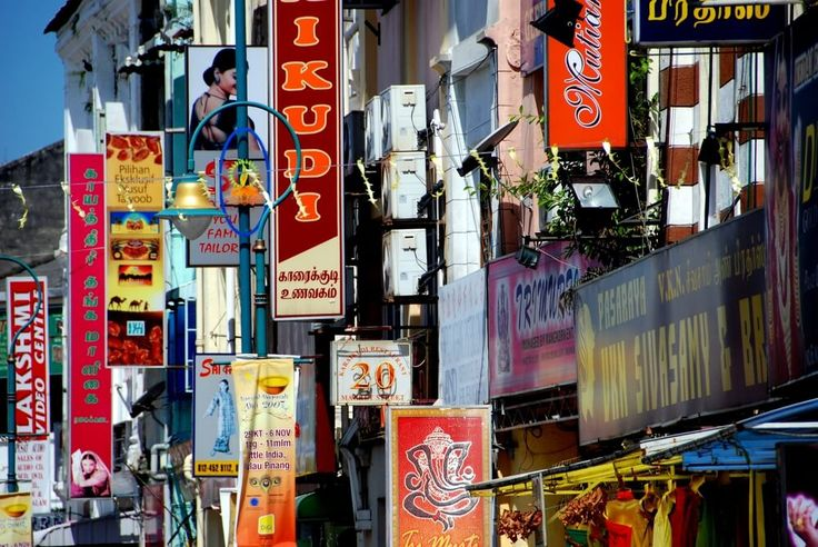 A melange of signs hang from storefronts on Lebuh Pasar in Little India. Photo by: LEE SNIDER PHOTO IMAGES / Shutterstock.com