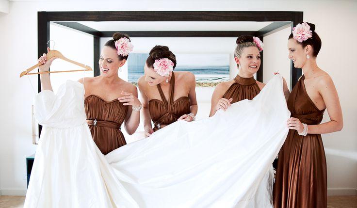 Port Douglas Weddings. Karlie's bridesmaids showing off her wedding dress.  www.shaunguestphotography.com.au
