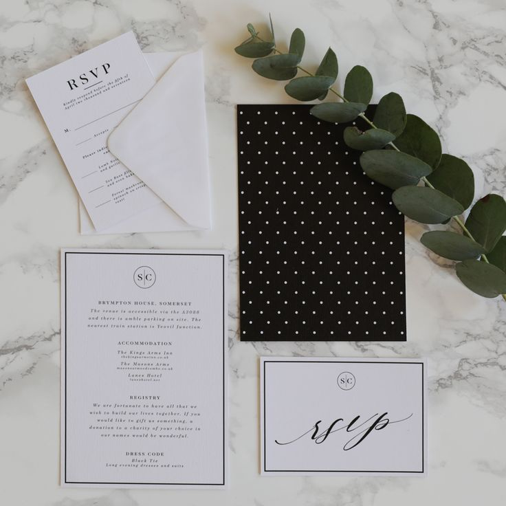 A classic and minimalist wedding stationery suite with romantic calligraphy style fonts and polka dot patterns. Black and white wedding stationery. Polka dot stationery. Classic and simple wedding stationery. Monogram wedding stationery. Simple wedding stationery. Elegant wedding stationery.