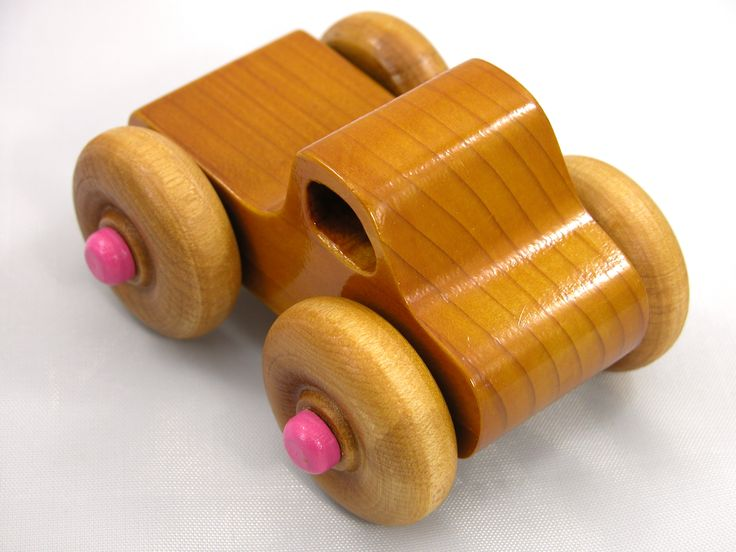 Handmade Wooden Toy Monster Truck Pine with Pink Hubs and Amber Shellac Finish #odinstoyfactory #handmade #woodentoytrucks #monstertrucks