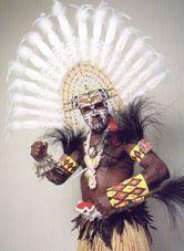Allson Edrick TABUAI (senior)  Saibai, Torres Strait, QLD 1933  Region:Saibai  Sub Origin:Torres Strait    Raindancer Dhibal [Headdress] 1999  feathers, lawyer cane, paint and twine  700 x 1000 x 200mm  Commissioned with funds from the Ilan Pasin Exhibition Grant 1999 1999  CRG reference code: 1999.40B  © Allson Edrick Tabaui