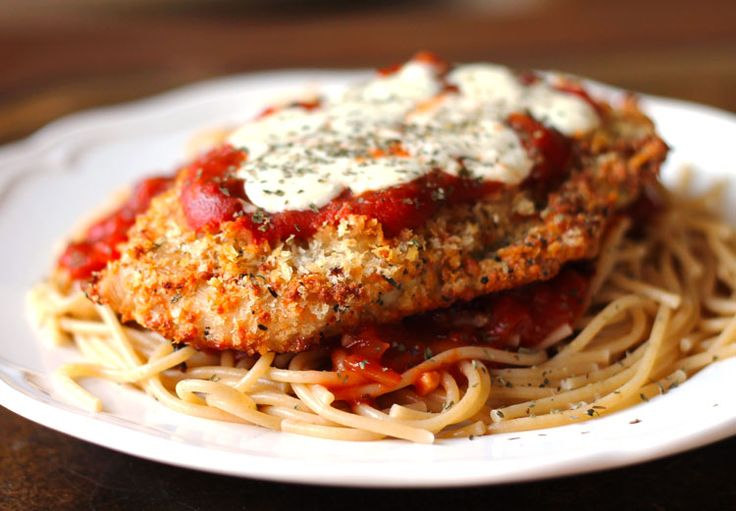 Oven-Baked Chicken Parmesan. Use #glutenfree breadcrumbs and brownrice pasta to make #glutenfree. Yum!