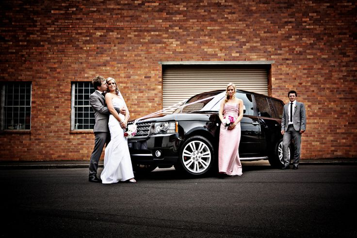 Bridal party + car + brick wall