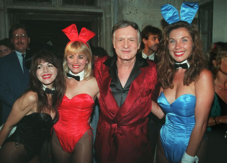 Hefner and some of his Playboy playmates.