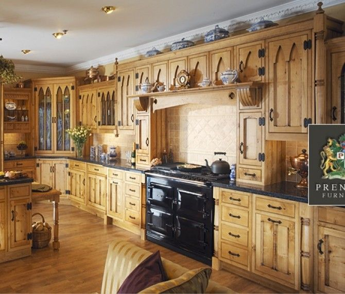 Oak bespoke kitchen in a timeless cathedral style.