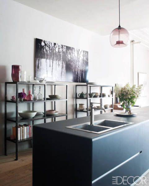 Manhattan couple Harriet Maxwell Macdonald and Andrew Corrie's kitchen features open shelving and a stunning Valcucine island.   - ELLEDecor.com