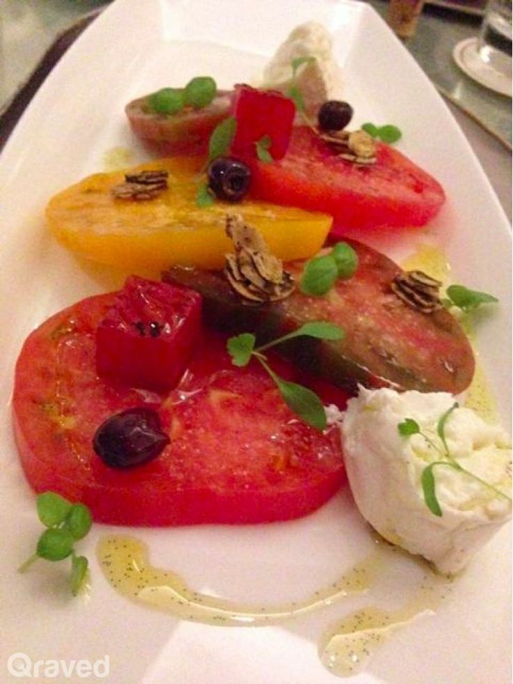 Heirloom tomatoes and burrata cheese at Chateau Blanc