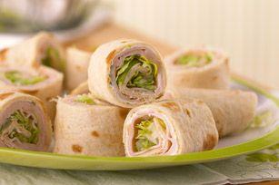 Easy Turkey-Tortilla Roll-Ups -- flour tortillas, chive & onion cream cheese, turkey breast, lettuce, tomato YUM