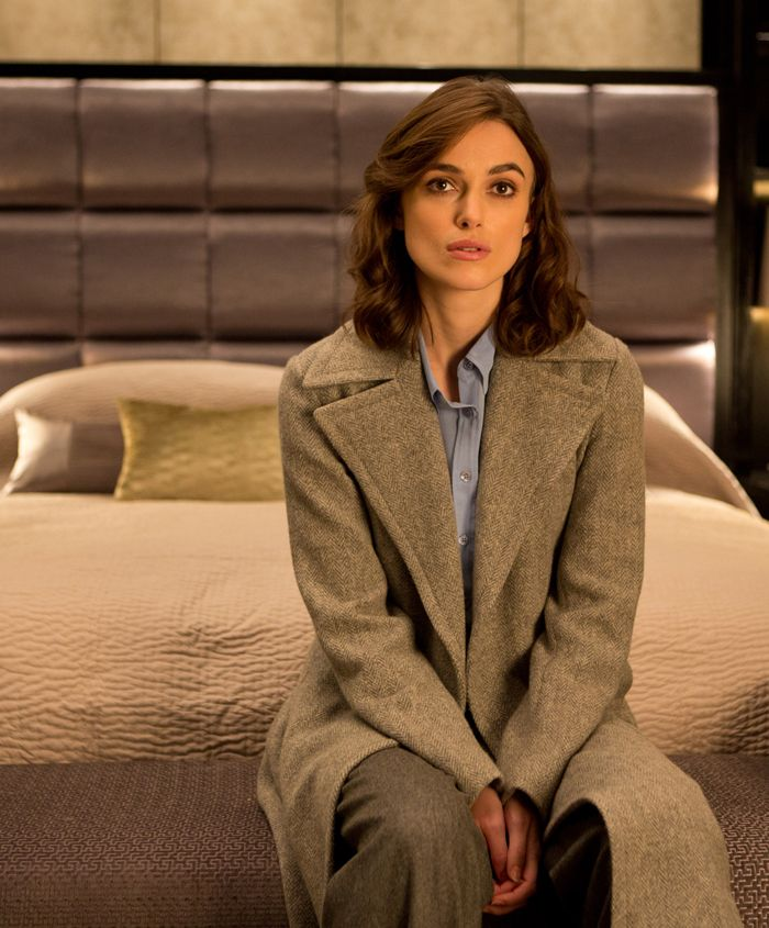 Cathy, simple & elegant: men's cut blouse, wide legged trousers, simple makeup (but w/ killer brows), grey, wide lapel coat