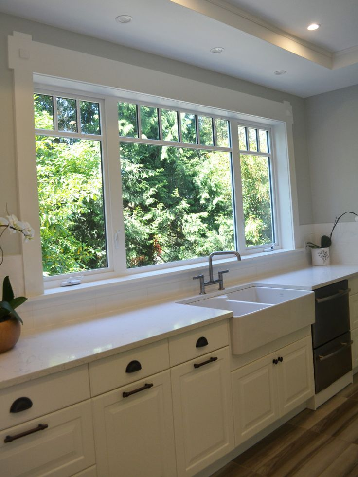 Check out the before pic. They replaced the window - this window makes the kitchen!!