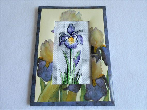 Cross stitched purple and yellow iris in a printed floral iris
