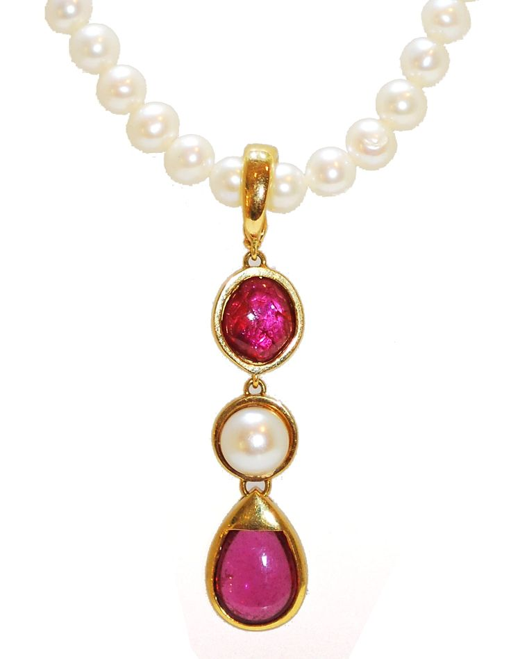 This multi functional pearl and gemstone necklace features a detachable pendant which enables the wearer to wear the pearls alone or the pendant on a different chain. The pendant incorporates Rubelite, Peal and a Pink Tourmaline drop into a stunning center point of the necklace. The contrasts of the pearl, gemstones and gold create a treasure cove around the neckline.