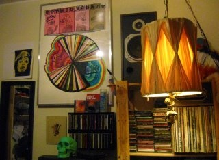 J.F's copy of Untitled is keeping his speaker company. http://www.etsy.com/listing/91546903/untitled-huge-9-color-screenprint-with