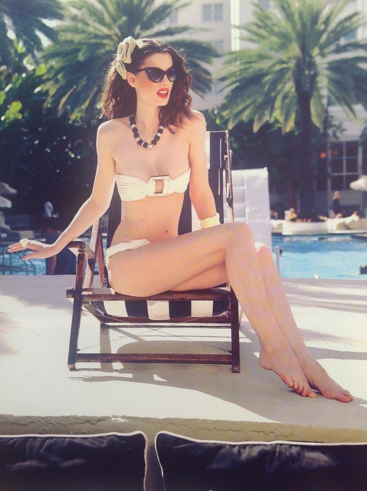 classy swimsuit posing.