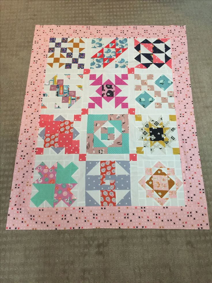 Baby girl quilt made of Cotton and Steele sampler