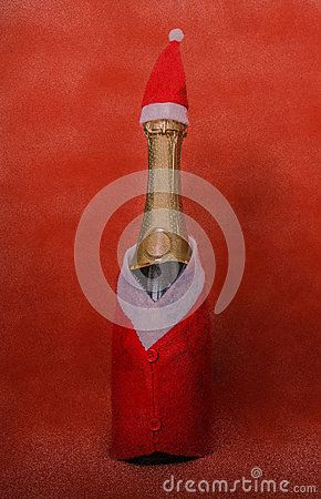 Picture with  bootle of champagne dressed in santa costume   #stock #picture #image #photo #christmas #newyear  #xmas #giftisolated on a red snow background