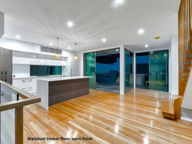 Timber floor sanding and polishing of Blackbutt timber with a satin finish.  This contemporary house is located in Bardon, Brisbane