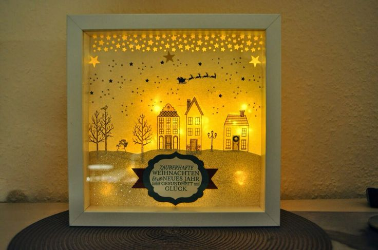 """Mit meinen Lieblingsweihnachtsstempeln """"Weiße Weihnacht"""" und dem Set """"Aus dem Häuschen"""" ist dieser beleuchtete Rahmen entstanden. Mehr Infos auf meinem Blog *stembelsche.blogspot.de*"""