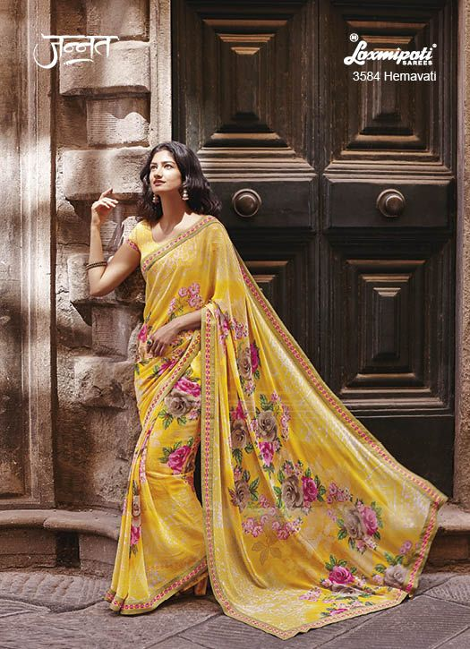 Alluring Yellow coloured Georgette Floral Printed Saree with Stunning Printed Lace which gives you the feel of being dipped in the soft pastles to the shade of warmth. It will be carrying Pashmina Rubbel Ducky Yellow Coloured Blouse with it. www.laxmipati.com