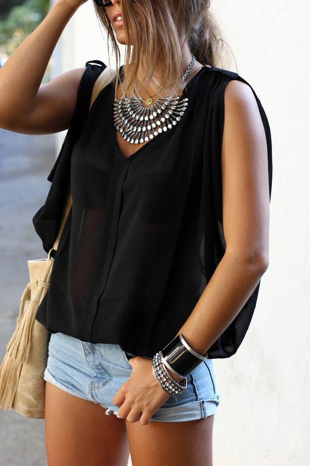 Street style | Black sheer blouse, denim shorts and statement necklace