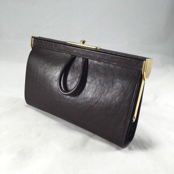 Hey, I found this really awesome Etsy listing at https://www.etsy.com/sg-en/listing/249192560/vintage-balenciaga-brown-clutch
