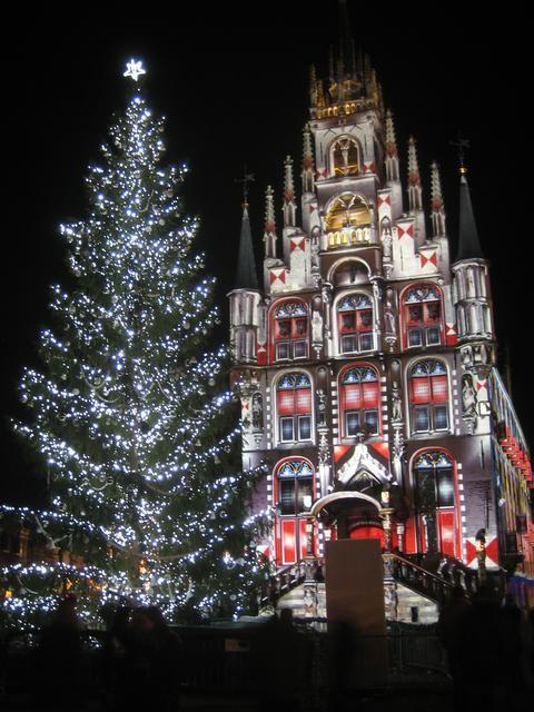 Illuminated town hall and Christmas tree, Gouda, Netherlands