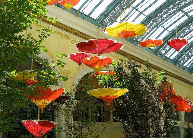 Romantic. I would have these for an outdoor wedding reception. Installation by Ingo Maurer. Also the paper flower umbrella installation for the spring celebration in the Bellagio's conservatory is ...