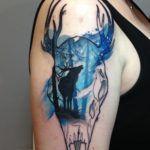 Deer & Skull on Girl's Upper Arm   Best tattoo ideas & designs