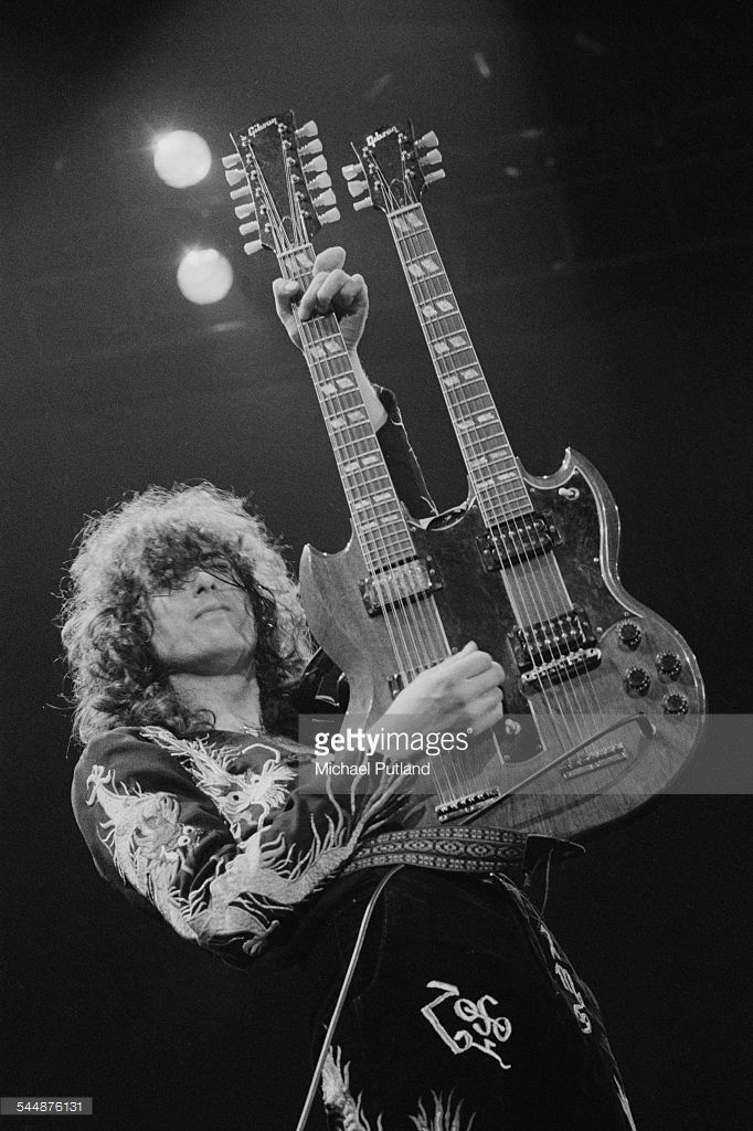 Jimmy Page playing a Gibson double neck guitar on stage with British heavy rock group Led Zeppelin, at Earl's Court, London, May 1975. The band were initially booked to play three nights at the venue, from 23rd to 25th May, but due to public demand, two more concerts were later added, for 17th and 18th May. Total ticket sales were 85,000.