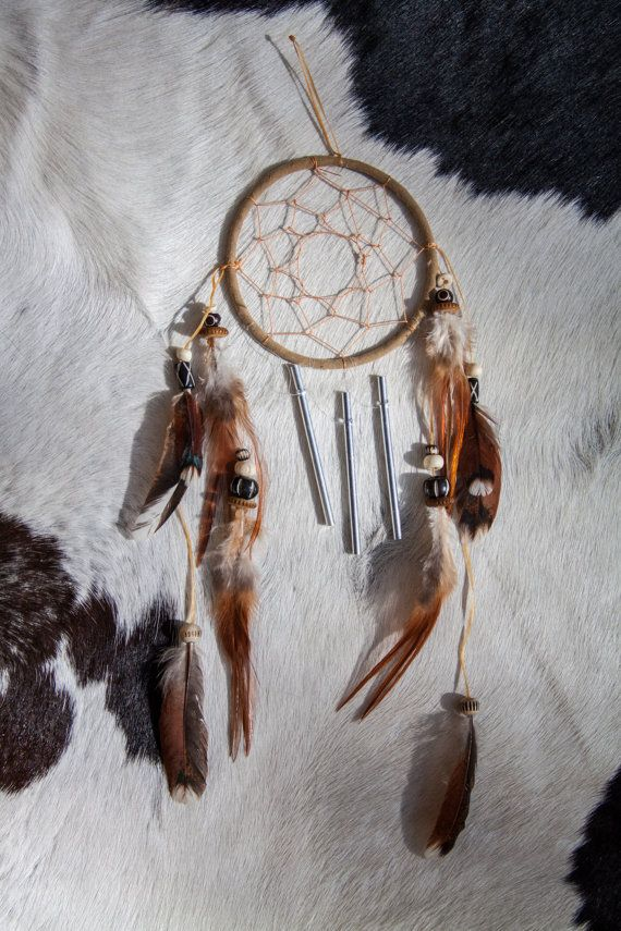 This dreamcatcher and windchime have rooster and hen feathers as well as bone beads.  Native Americans of the Great Plains believe the air is filled with both good and bad dreams. Historically, dreamcatchers were hung in the tipi or lodge and on a babys cradle board.  According to legend, the good dreams pass through the center hole to the sleeping person. The bad dreams are trapped in the web, where they perish in the light of dawn.   Symbol meanings of the Rooster are as vibrant and…