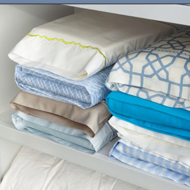 Straighten up your linen closet: store sheet sets inside one of the pillow cases