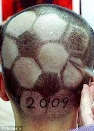 Soccer shaved head.