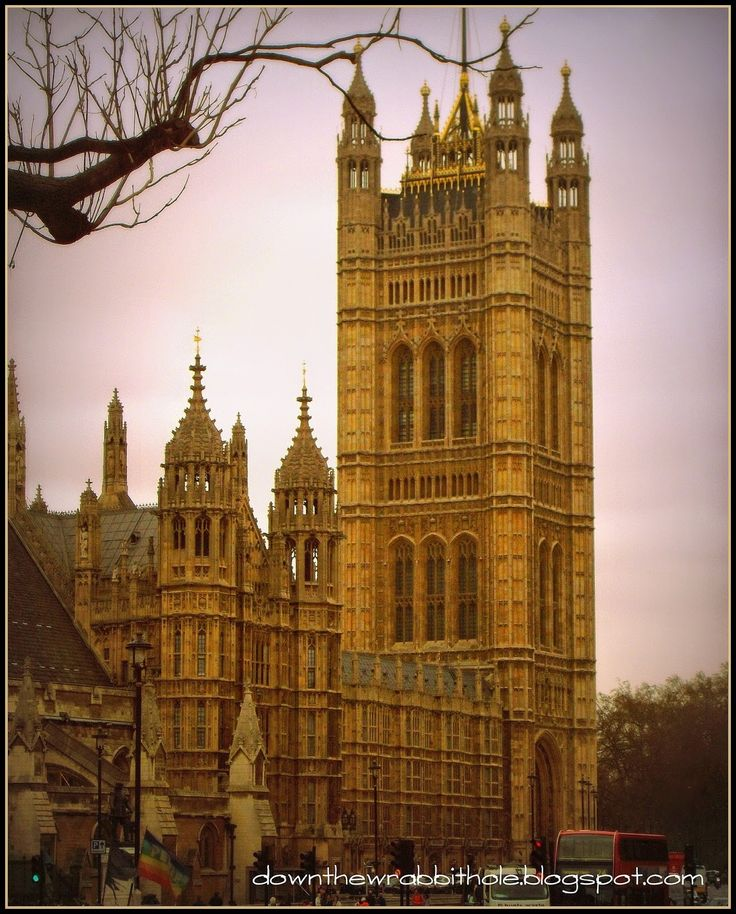 """The British Parliament building in London, one of our stops during our London bus tour. Find out more at """"Down the Wrabbit Hole - The Travel Bucket List"""". Click the image for the blog post."""