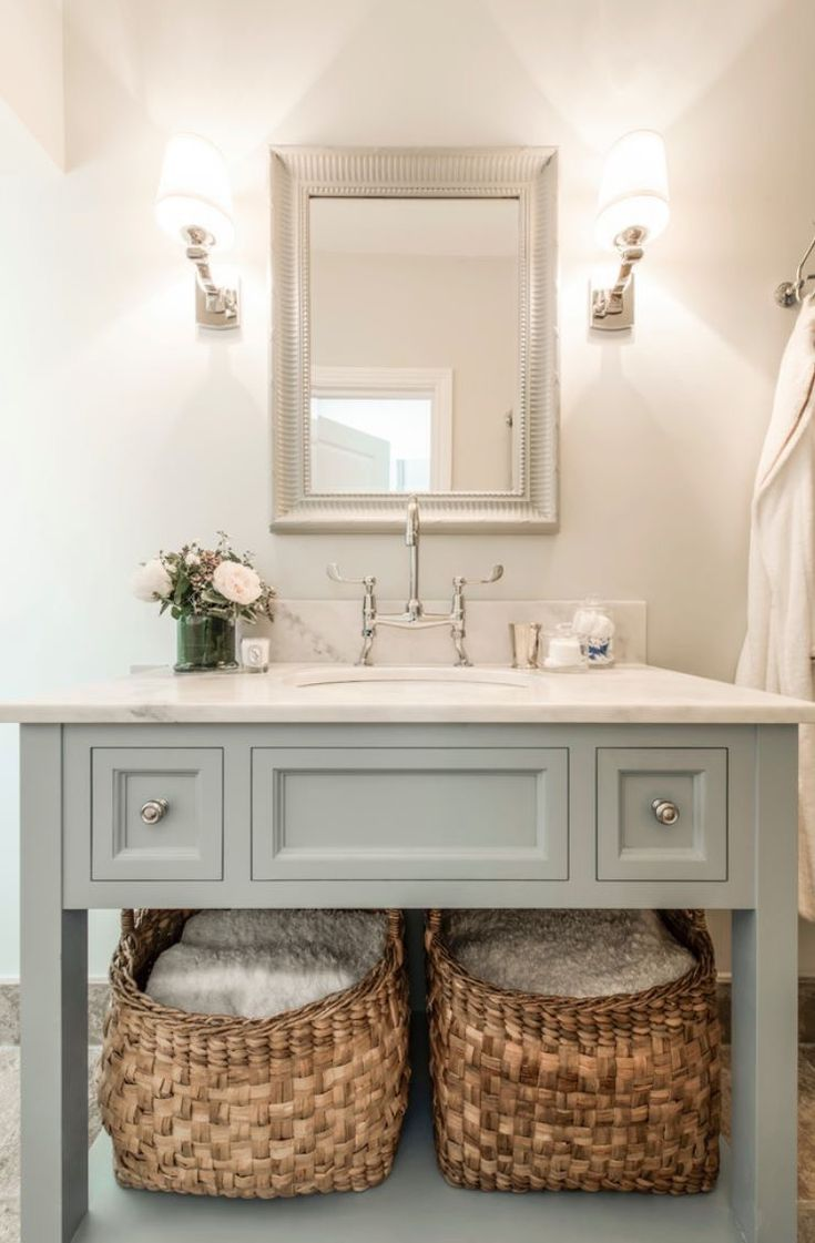 Bathroom vanity with baskets under for decorative storage.