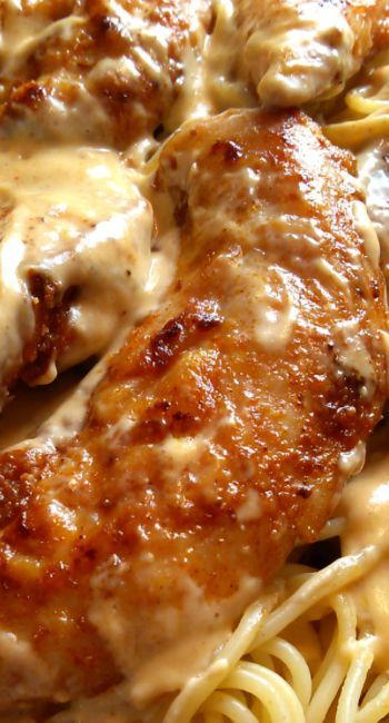 Chicken Lazone ~ Seasoned Chicken Pan-Fried in Butter with a Super easy Cream Sauce Served over Pasta.