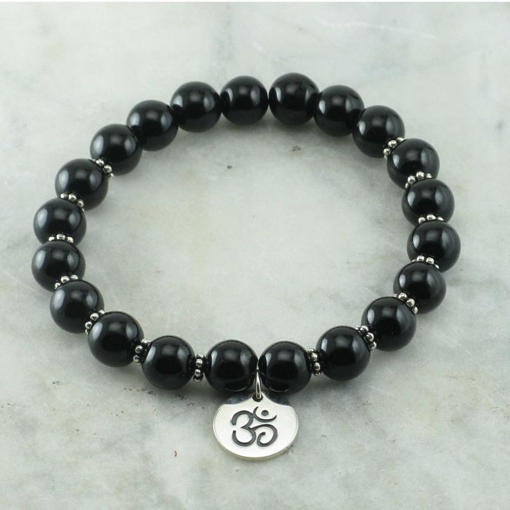 The Perception Chakra Bracelet is made from 21 black onyx mala beads. Sterling…