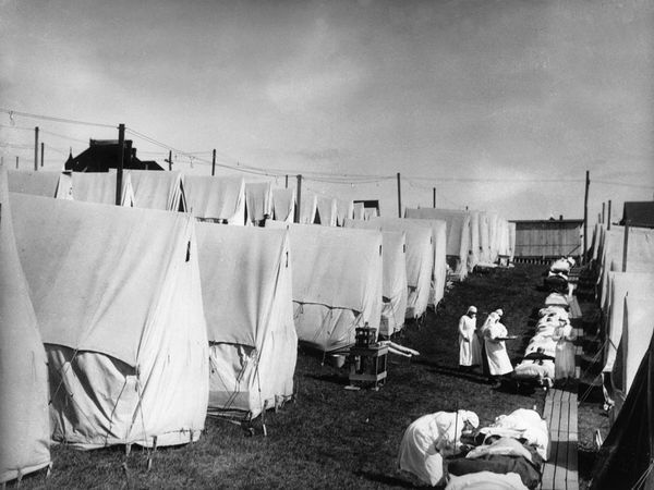 Under siege by the Spanish flu epidemic of 1918, nurses in Lawrence, Massachusetts, treat patients in an outdoor hospital. Canvas tents kept the sick separated and less likely to spread the deadly virus. And with the success of fresh-air therapy on tuberculosis outbreaks, public health officials strongly recommended taking them outside.