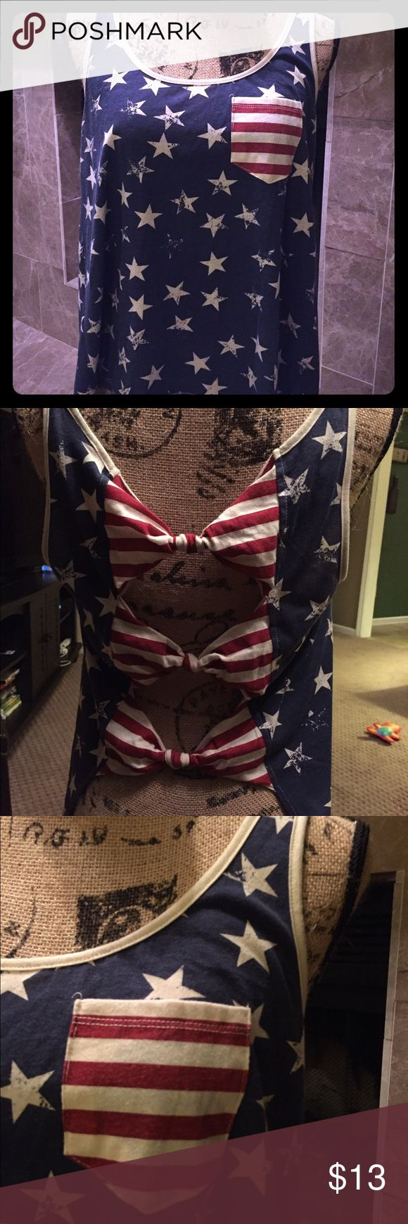 Patriotic Tank Top Patriotic tank top with an open back tied together by 3 knotted bows - As pictured - and a front pocket. Perfect for 4th of July or any time during the summer! Gently used, great condition with no signs of wear and tear. Rue 21 Tops Tank Tops