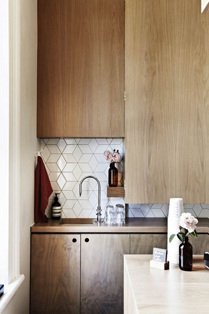 Natural cabinets and beautiful geometric backsplash