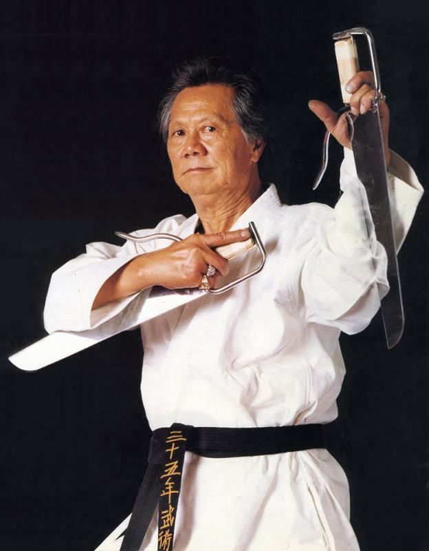 Grandmaster Jimmy H. Woo. This photo is from a private set he had photographed for his family. In this photo he is holding a pair of butterfly swords. Mr Woo. passed away in 1991. The legacy lives on in the many thousands of lives he touched by teaching his secret family art, Kung Fu San Soo. The International Kung Fu San Soo Association is committed to passing on this powerful art in the way he taught it.