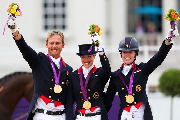 Charlotte Dujardin Photos Photos - (L-R) Carl Hester, Laura Bechtolsheimer and Charlotte Dujardin of Great Britain celebrate with their gold medals during the medal cerermony for the Team Dressage on Day 11 of the London 2012 Olympic Games at Greenwich Park on August 7, 2012 in London, England. - Olympics Day 11 - Equestrian