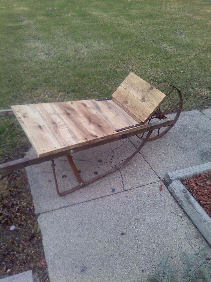 recycled pallet wood and old wheelbarrow parts