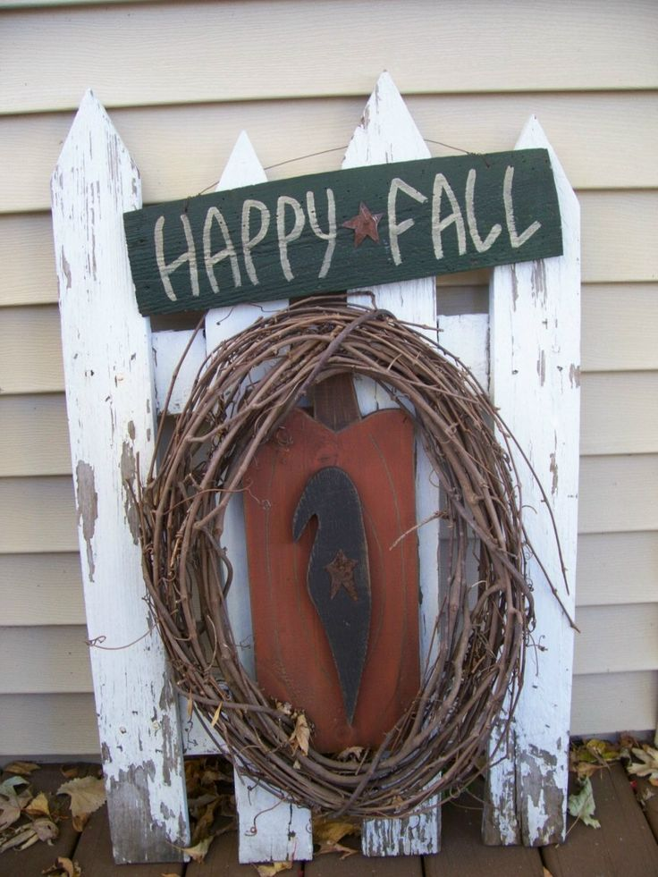 An old piece of picket fence can become a primitive looking fall decoration! One of our favorites.